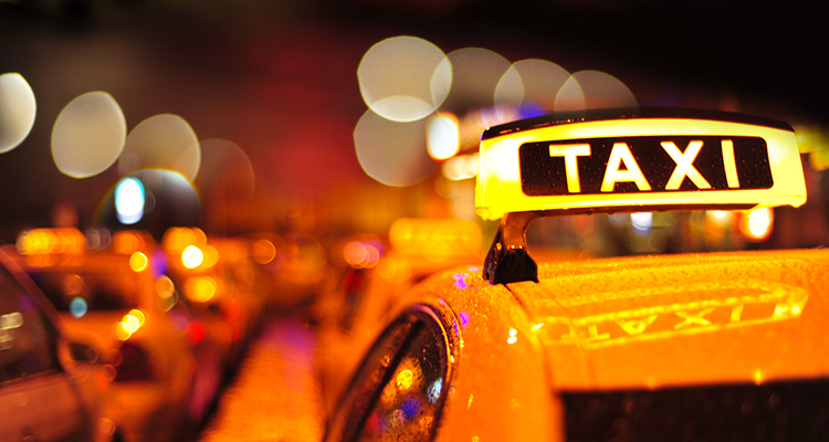 Yellow taxi with lighted taxi sign