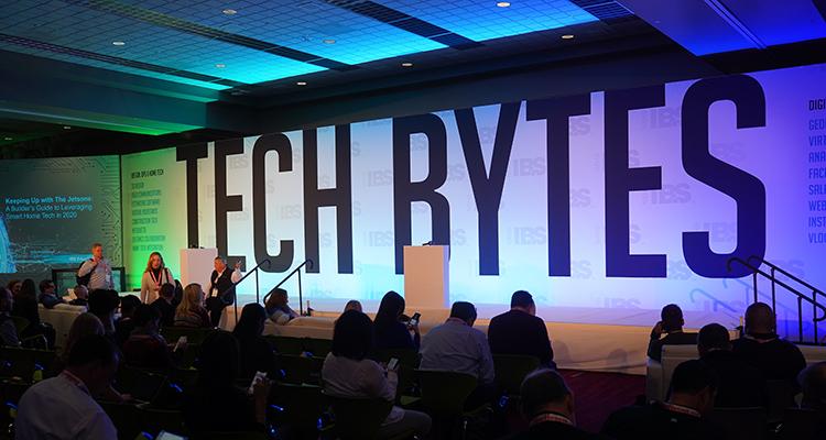 Tech Bytes sign faces audience