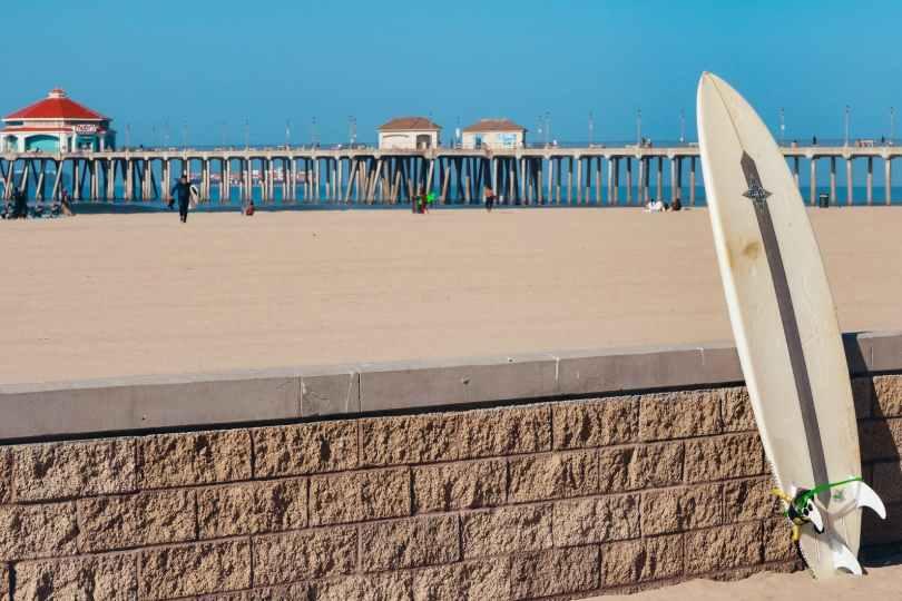 a surfboard on a brick fence