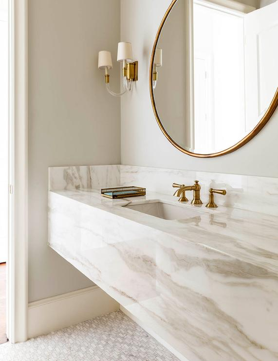 Neutral bathroom with modern brass finishes