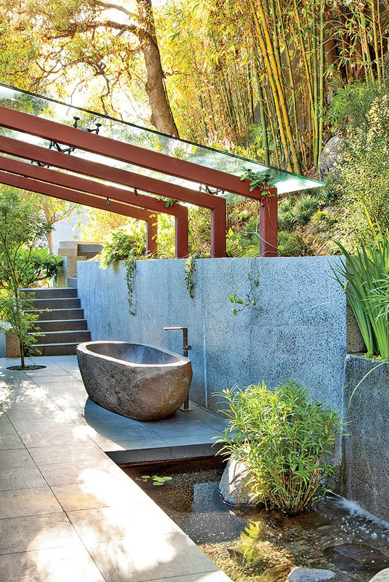 Glass Rooftop Over a Soapstone Bath