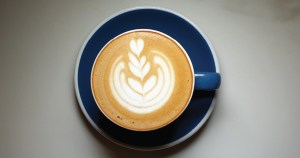 cappuccino on plate with leaf