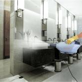 Sanitizing sprayer cleans bathroom