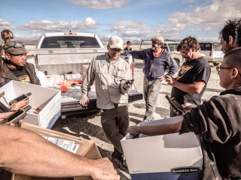 Armed with boxes, bags and GPS units, the inspection teams are briefed by the BLM.