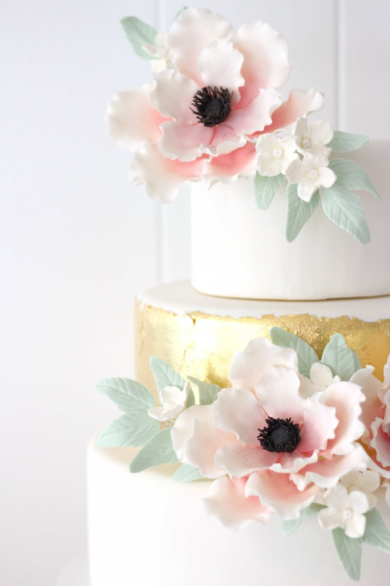 wedding cake with gold leaf and sugar flowers from bakery in sussex county nj