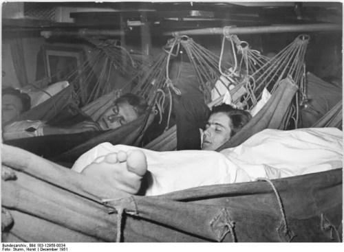 Sailors Sleeping In Hammocks On A Ship