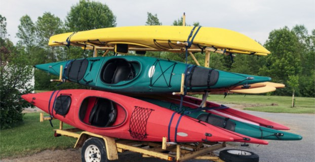 A Yellow Used Kayak Trailer Holding Five Kayaks