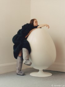 capture one RAW photo editor femininity blogpost Annie Lai woman in boots standing over egg shaped sculpture