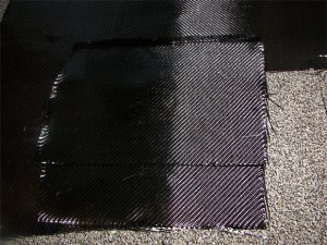 Two squares of carbon fiber