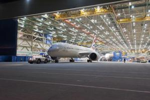 Boeing rolls out first 787 at increased production rate