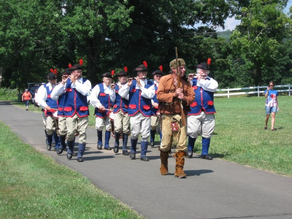 Stony Creek Fife and Drum Corps marching down the driveway.