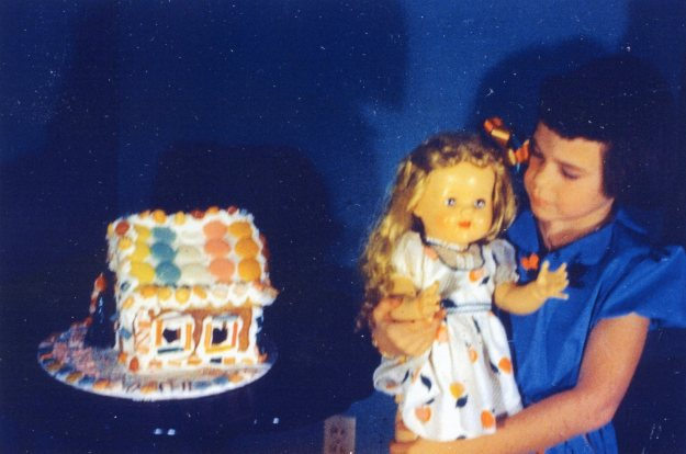 Carol with the gingerbread house and the new doll