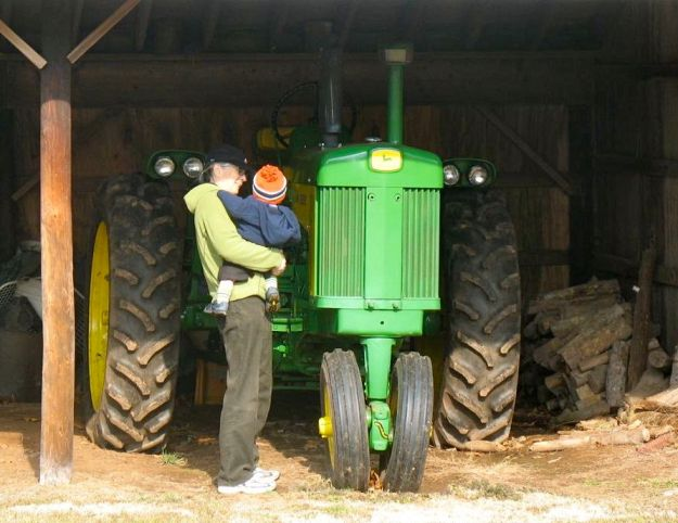 Carol and Henry with the new tractor, 2008