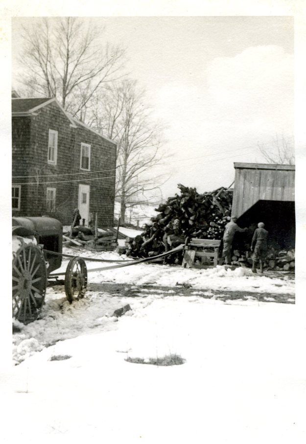 Cutting wood from the woodpile with the Farmall tractor, 1939