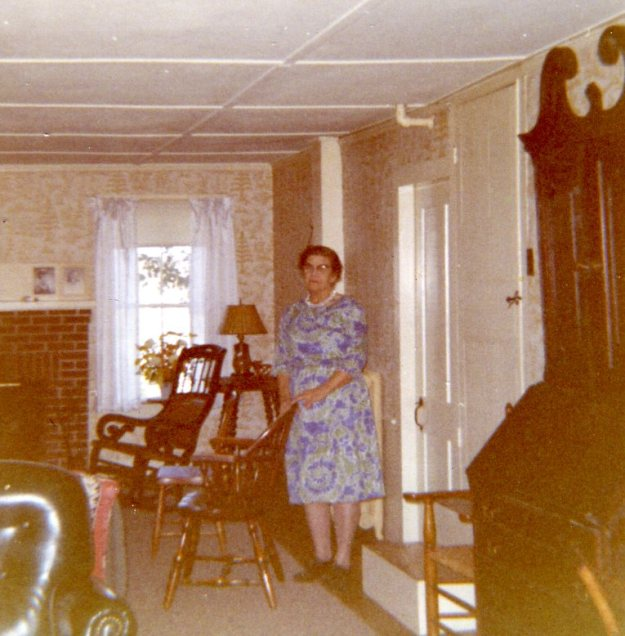 Grandma Hall standing in the living room near her bedroom door, around 1962