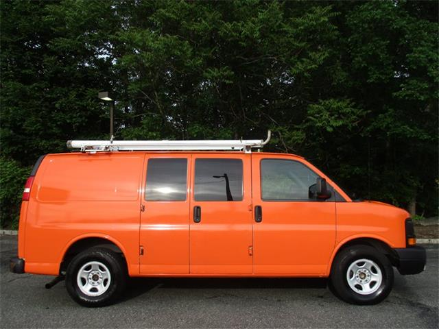 An orange Chevrolet Express Van
