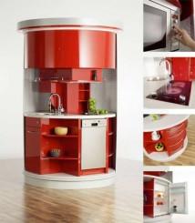 un grande cilindro con all'interno ripianni e tutti gli elettrodomestici essenziali della cucina tradizionale.