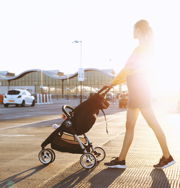 mother walking child in stroller