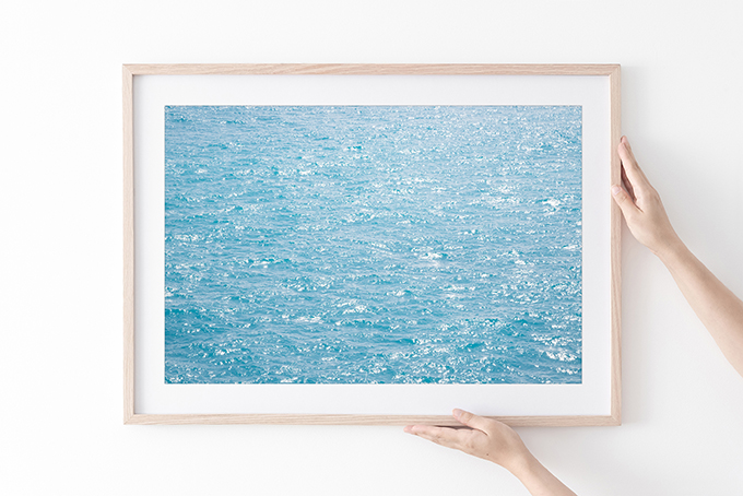 Happy Blues - Sun glitter on water art print in natural frame by Cattie Coyle Photography
