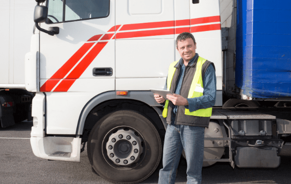 a person standing in front of a truck