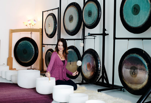 Jamie Ford plays her soothing and mystical gongs and crystal bowls