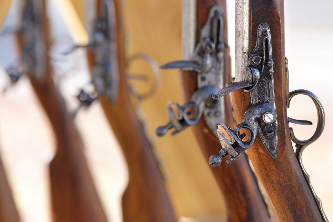 Civil War muskets aligned in a gunsmith