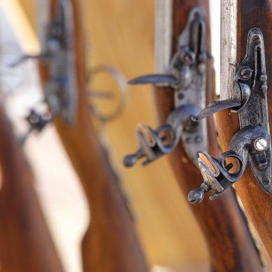Civil War muskets aligned in a gunsmith