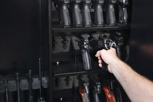 safe filled with handguns on racks