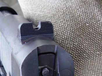 Custom rear sight on a pistol