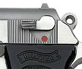 Silver barreled, black handled Walther PPK with a focus on the safety mechanism, against a white background