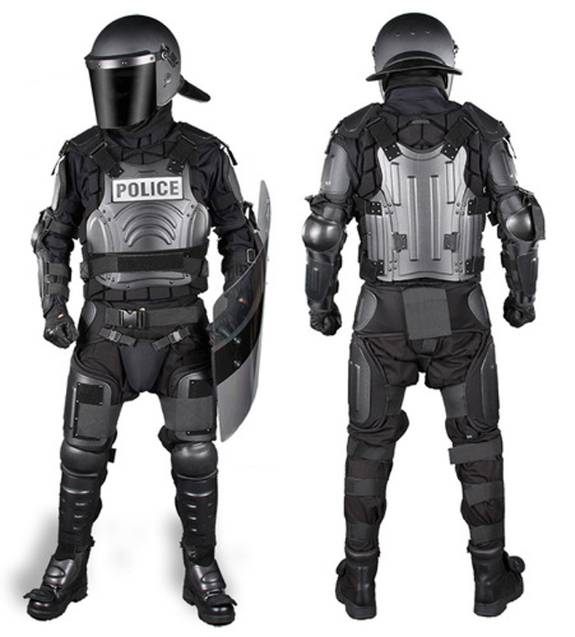 Picture shows a man dressed in a complete riot control armor suit.