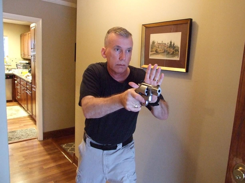 Scott Wagner holding a revolver for home defense.