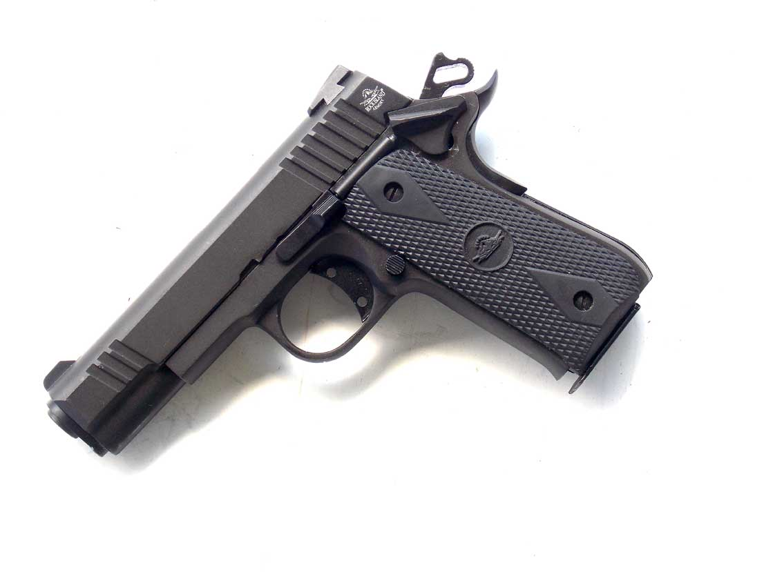 Baby Rock pistol pointing down at 45 degree angle in black