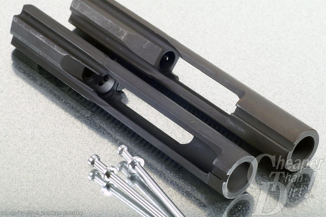 Black bolt carrier assembly on a light gray background