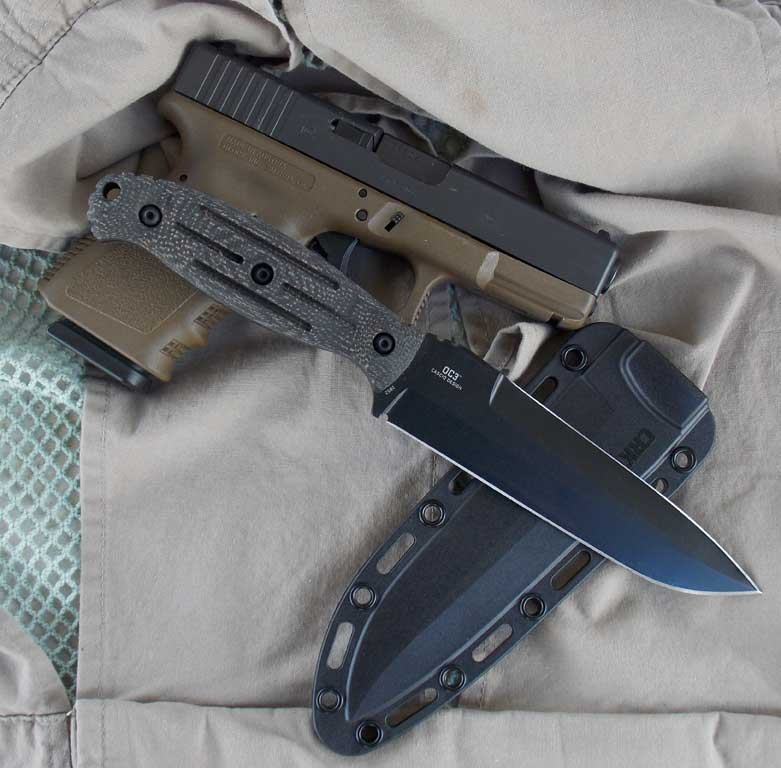 CRKT OC3 knife laid across sheath and Glock handgun
