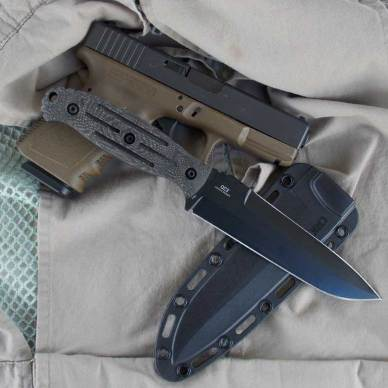CRKT OC3 knife laid across sheath and Glock handgun