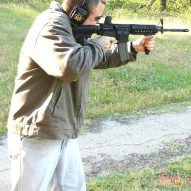 Captain Campbell is wringing out the Daniel Defense rifle.