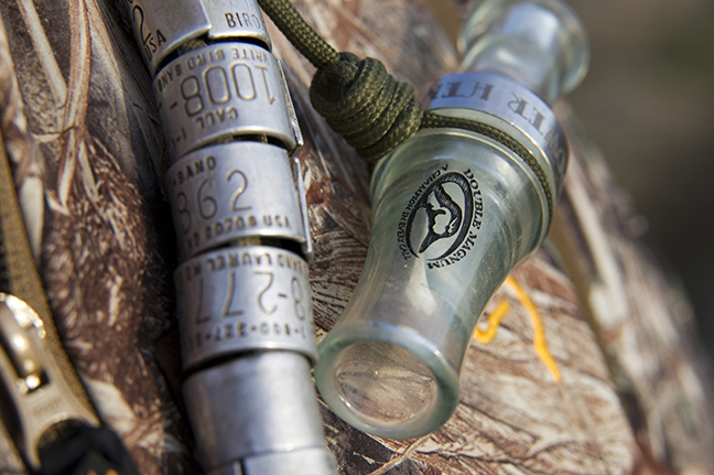 Duck call on lanyard with several bird leg bands