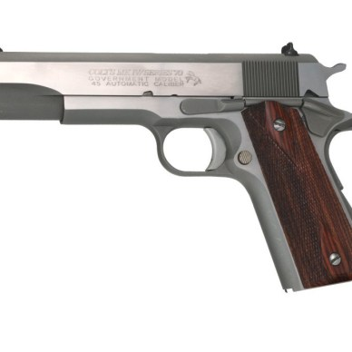 Brown grip, silver barreled Colt Series 70 with barrel pointing to the left on a white background.