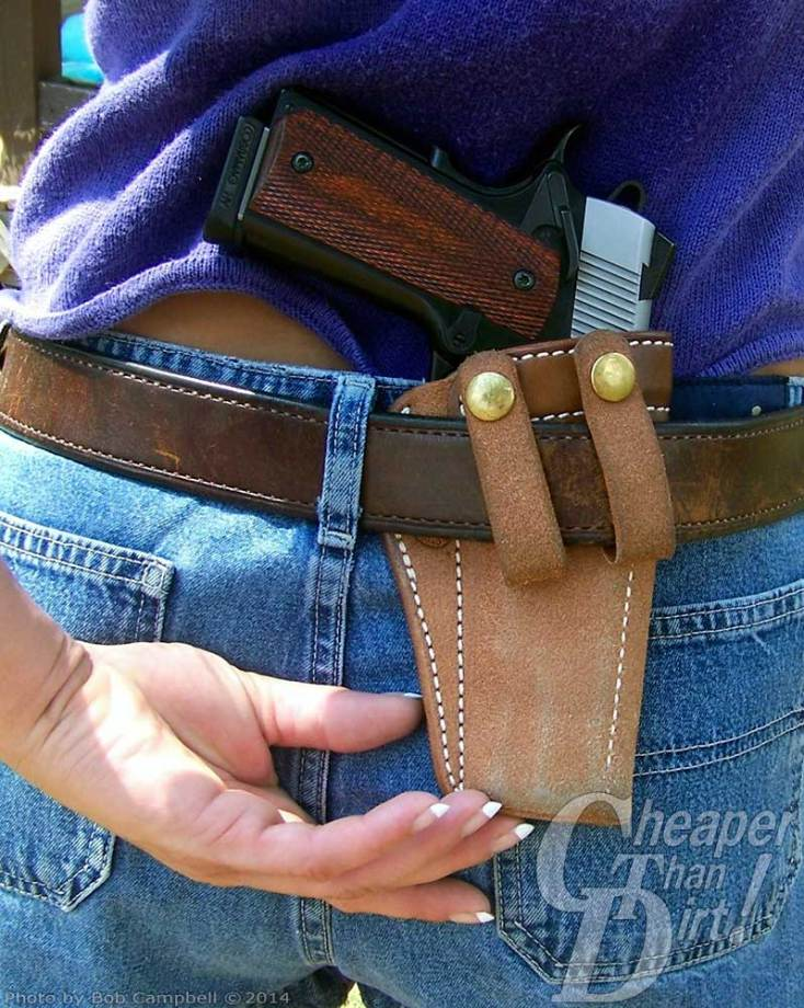 Pale tan IWB holster shown positioned on a woman wearing a purple shirt and jeans.