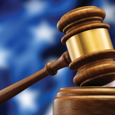 Gavel in front of a blurred out American flag