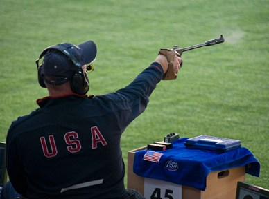 Eric Hollen, a U.S. Army veteran and Paralympic athlete, competes in a 50-meter pistol competition.