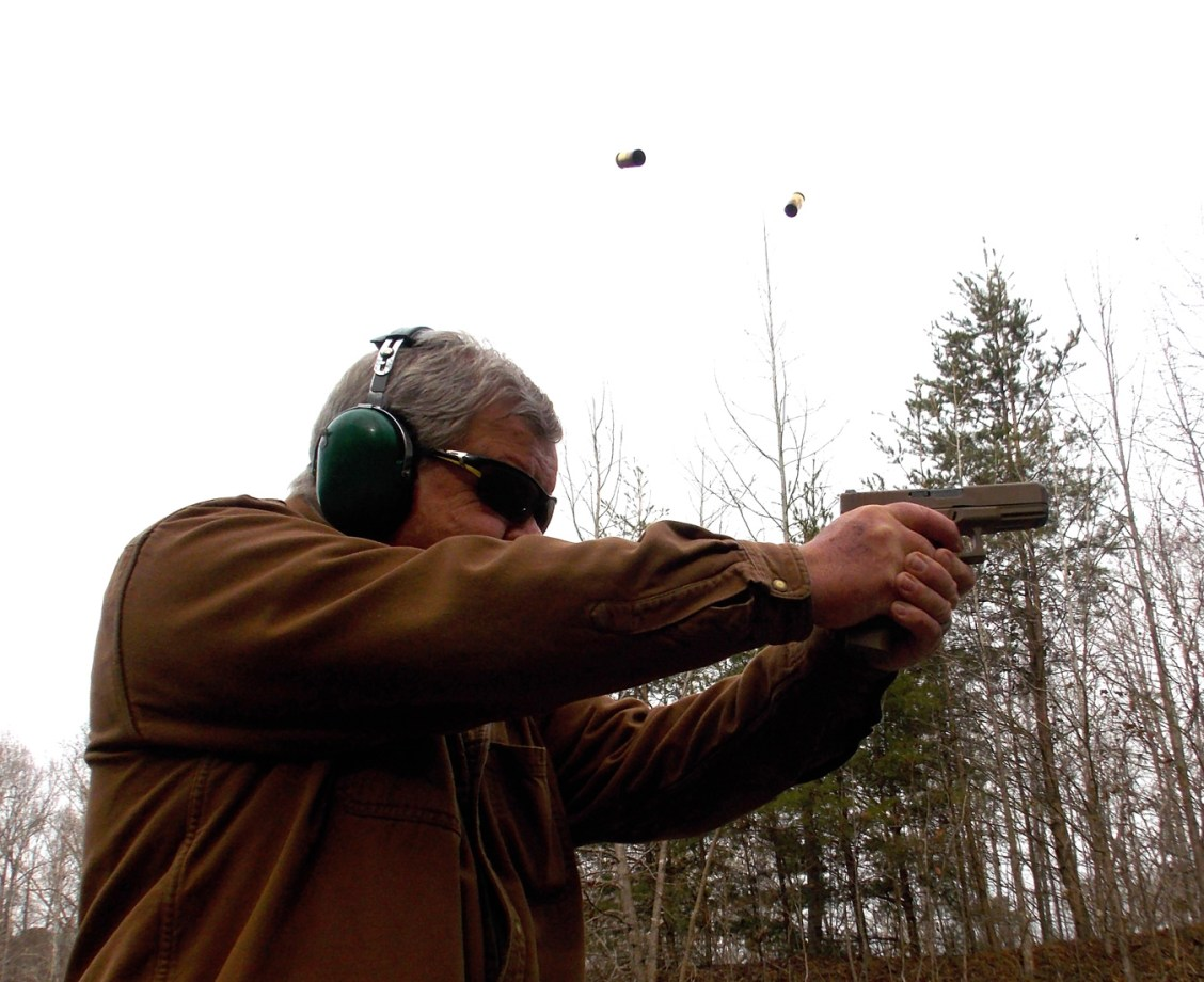 Bob Campbell shooting the Glock 19X with two spent shell cases in the air