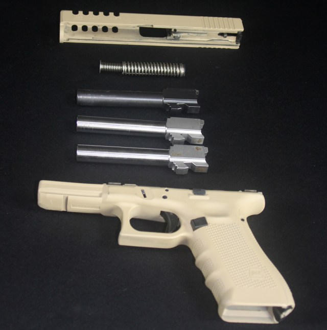 Tan Glock 22 with .40S&W, 9mm and .357 SIG barrels
