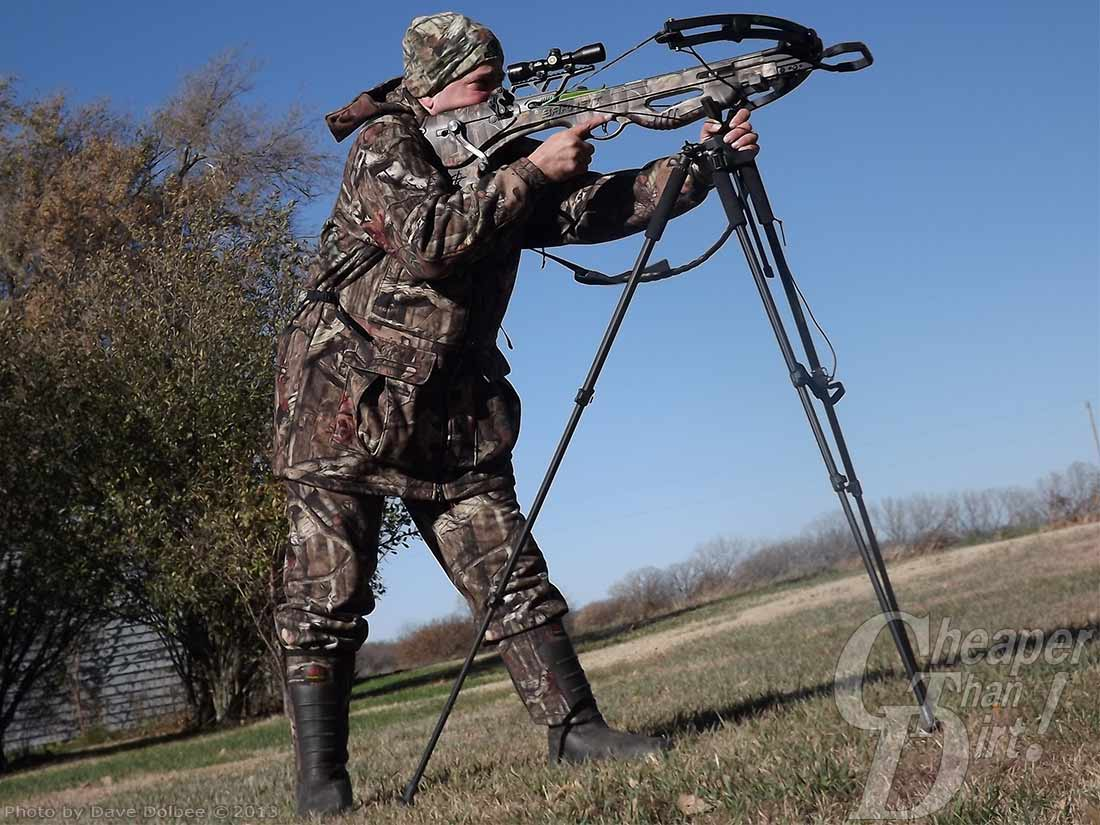 Hunter in camo shooting crossbows from 4-foot high shooting sticks
