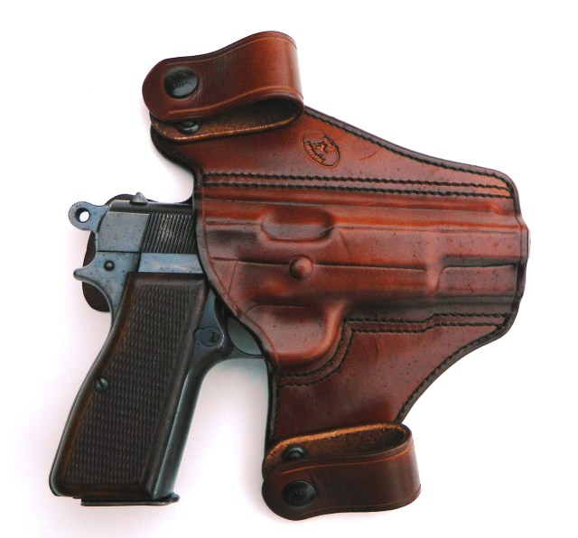 Browning Hi-power pistol in leather holster