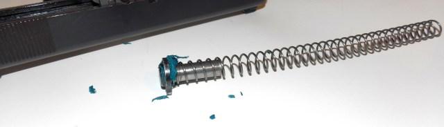 semi-automatic pistol spring with broken shock buffer
