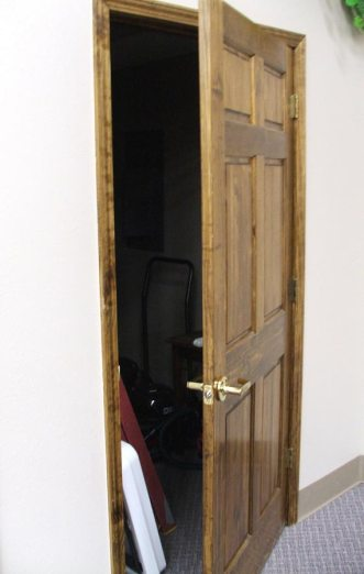 Partially opened wood door to a closet.