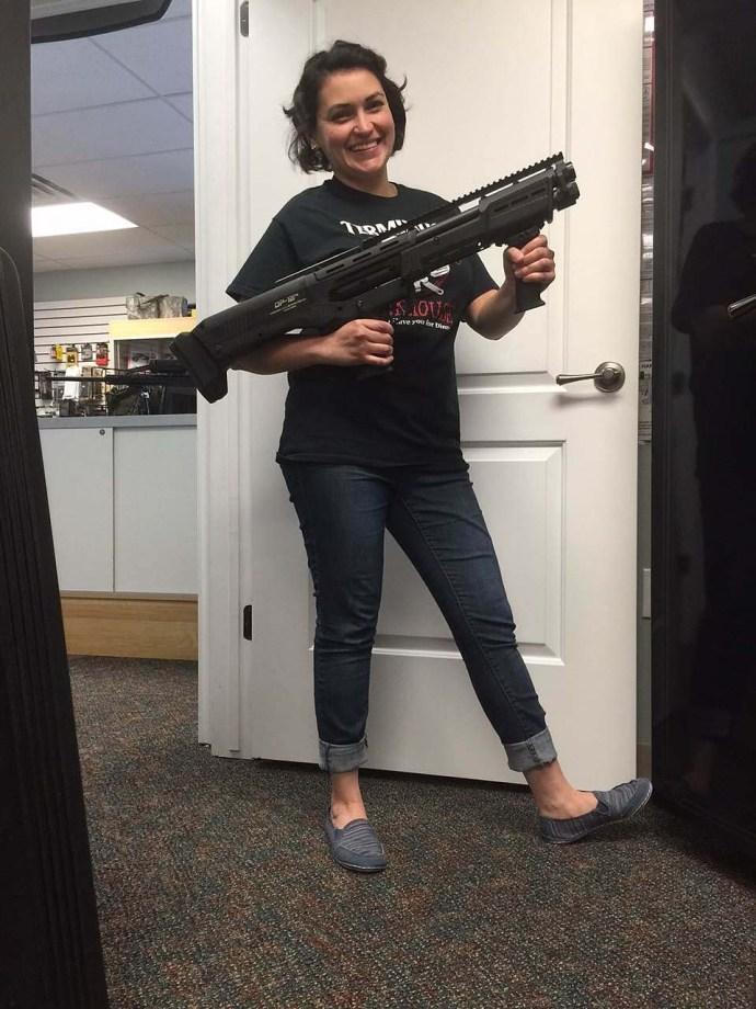 Woman with double-barreled DP-12 semiautomatic shotgun