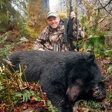 Dave Dolbee with Marlin X7 rifle and Black Bear